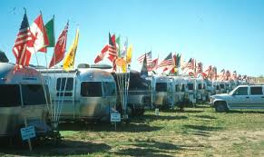 row airstreams with flag pole holders